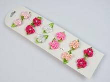 Colita con flor color, perlita y hojitas